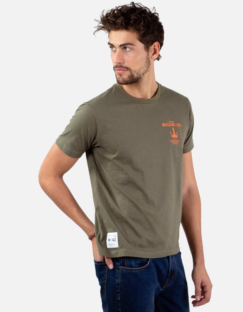 Green t-shirt with printed letters.